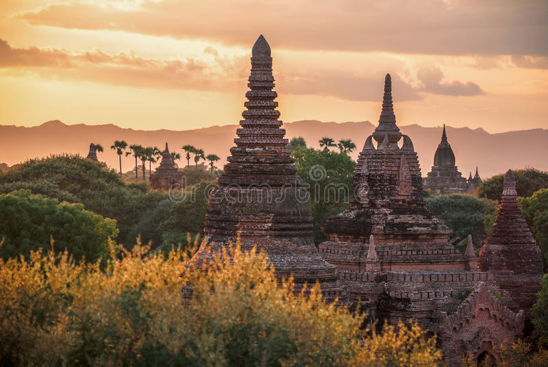 Sunset over Bagan, Myanmar. Stupas of Buddhist temple in Bagan, Myanmar, in the sunset light royalty free stock photos