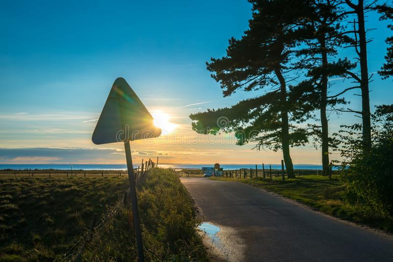 Sunset over baltic sea in sweden beautiful colours. And sign in foreground stock photography