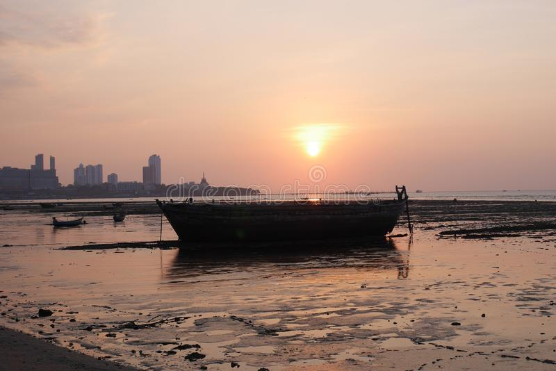 Sunset over the bay in Naklua Thailand at low tide royalty free stock photo