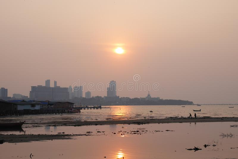 Sunset over the bay in Naklua Thailand at low tide royalty free stock image