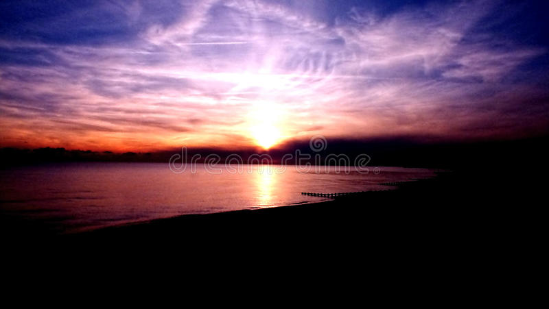 Sunset over beach stock images