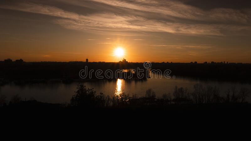 Sunset over Belgrade, Serbia from Kalemegdan Fortress. Panorama View of city skyline ,Danube and Sava rivers merging royalty free stock images