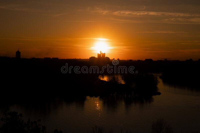 Sunset over Belgrade, Serbia from Kalemegdan Fortress. Panorama View of city skyline ,Danube and Sava rivers merging royalty free stock photography