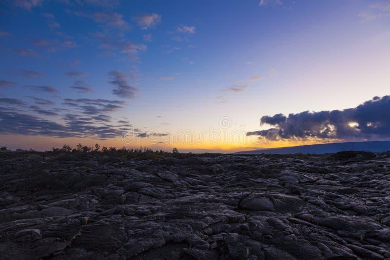 Sunset over black volcanic rock. Sunset on Kilauea newly formed slopes stock photos