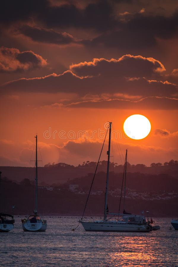 Sunset over boats in marina royalty free stock photography