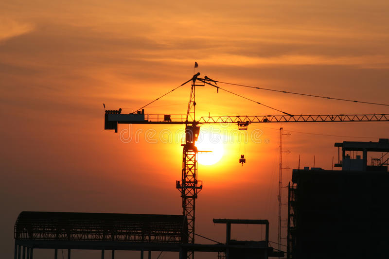 Sunset over building construction. royalty free stock photo