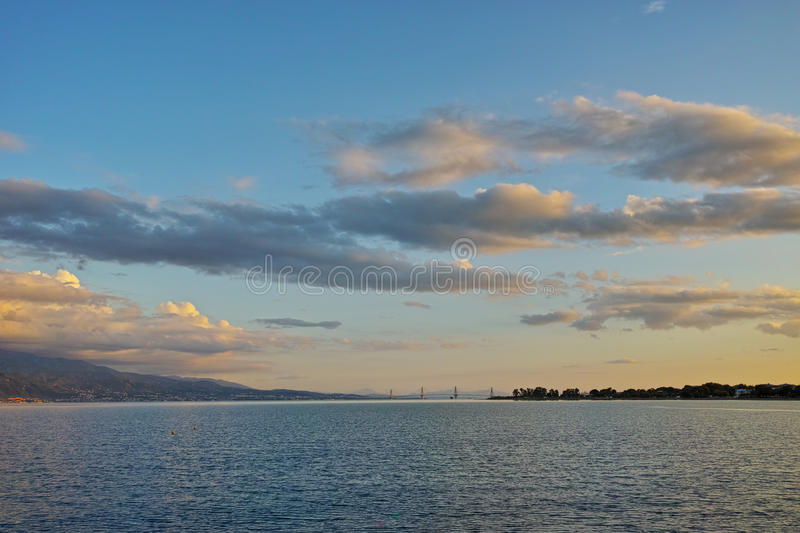 Sunset over The cable bridge between Rio and Antirrio view from Nafpactos, Patra, Greece. Sunset over The cable bridge between Rio and Antirrio view from stock image