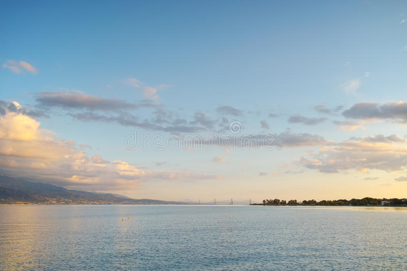 Sunset over The cable bridge between Rio and Antirrio view from Nafpaktos, Patra, Greece. Sunset over The cable bridge between Rio and Antirrio view from royalty free stock photos