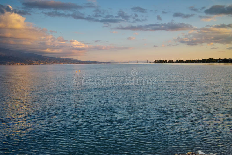 Sunset over The cable bridge between Rio and Antirrio view from Nafpaktos, Patra, Greece. Sunset over The cable bridge between Rio and Antirrio view from stock image