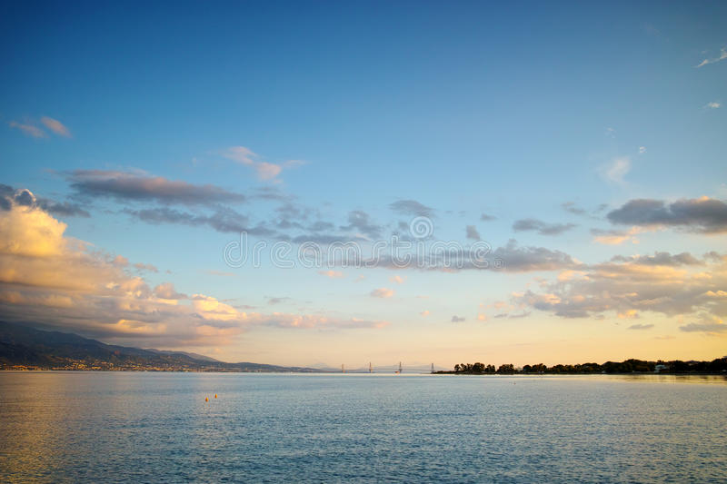 Sunset over The cable bridge between Rio and Antirrio view from Nafpaktos, Patra, Greece. Sunset over The cable bridge between Rio and Antirrio view from stock photography