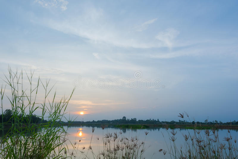 Sunset over the calm lake. Tranquil lake with sunset in summer royalty free stock photo