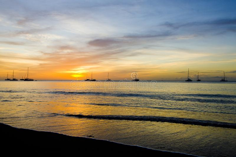Sunset over the Caribbean Sea, Grand Anse Bay, Grenada. Outdoor, outdoors, outside, exterior, exteriors, america, central, greater, antilles, lesser, west stock photos