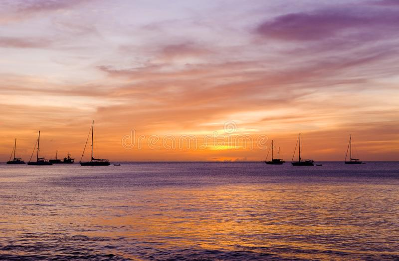 Sunset over the Caribbean Sea, Grand Anse Bay, Grenada. Outdoor, outdoors, outside, exterior, exteriors, america, central, greater, antilles, lesser, west royalty free stock images