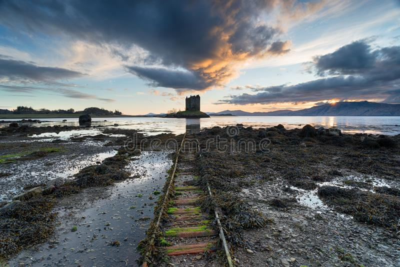 Sunset over Castle Stalker. Dramatic sunset sky over the ruins of Castle Stalker on the shores of Loch Linnhe near Appin in Argyll in Scotland royalty free stock images