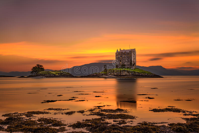 Sunset over Castle Stalker, Scotland, United Kingdom. Sunset over Castle Stalker, Highlands, Scotland, United Kingdom. Long exposure and hdr processed royalty free stock photo