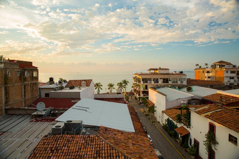 Sunset over Centro Puerto Vallarta. Sun setting over rooftops and ocean in Centro Puerto Vallarta, Jalisco, Mexico stock photography