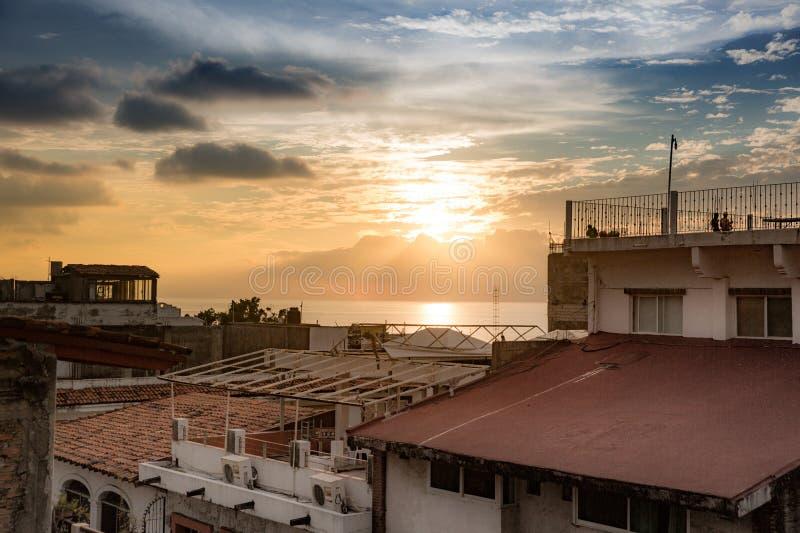 Sunset over Centro Puerto Vallarta. Sun setting over rooftops and ocean in Centro Puerto Vallarta, Jalisco, Mexico stock image