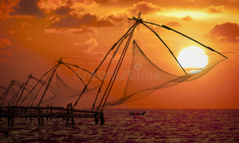 Sunset over Chinese Fishing nets in Cochin stock photos