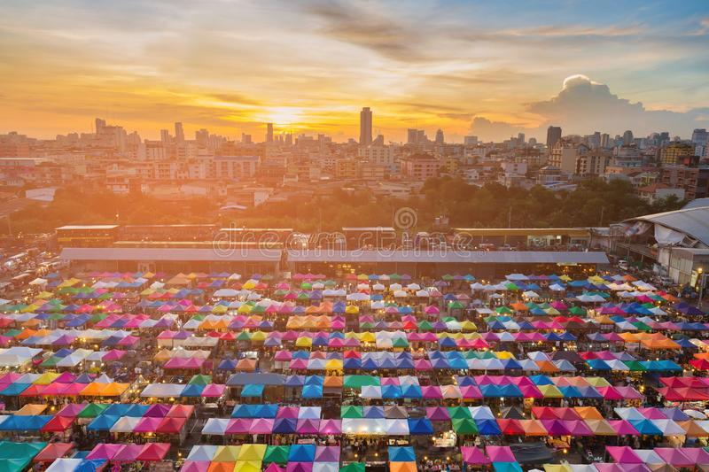Sunset over city flea market aerial view royalty free stock photo