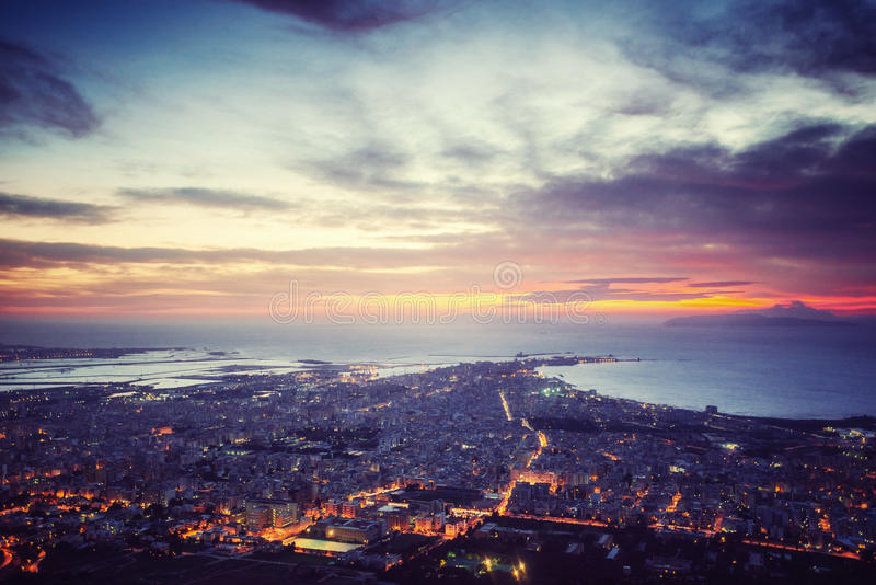 Sunset over the city from on high. The dramatic and picturesque scene. Location Trapani, Erice, Sicily, Italy, Europe. Mediterranean and Tyrrhenian Sea royalty free stock photography