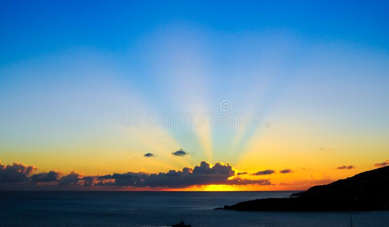 Sunset over coastline stock images