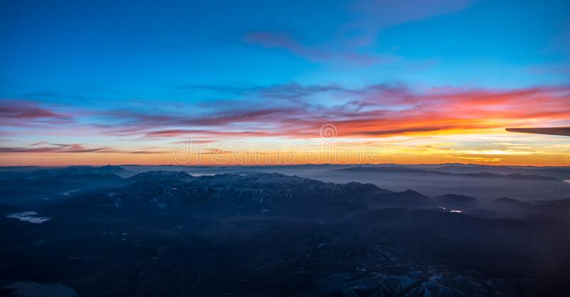 Sunset over colorado rockies from an airplane. Sunset over colorado  rockies from an airplane royalty free stock image
