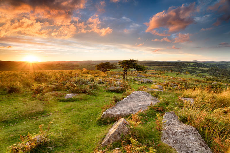 Sunset over Dartmoor. Stunning sunset from Combestone Tor on Dartmoor in Devon stock photography