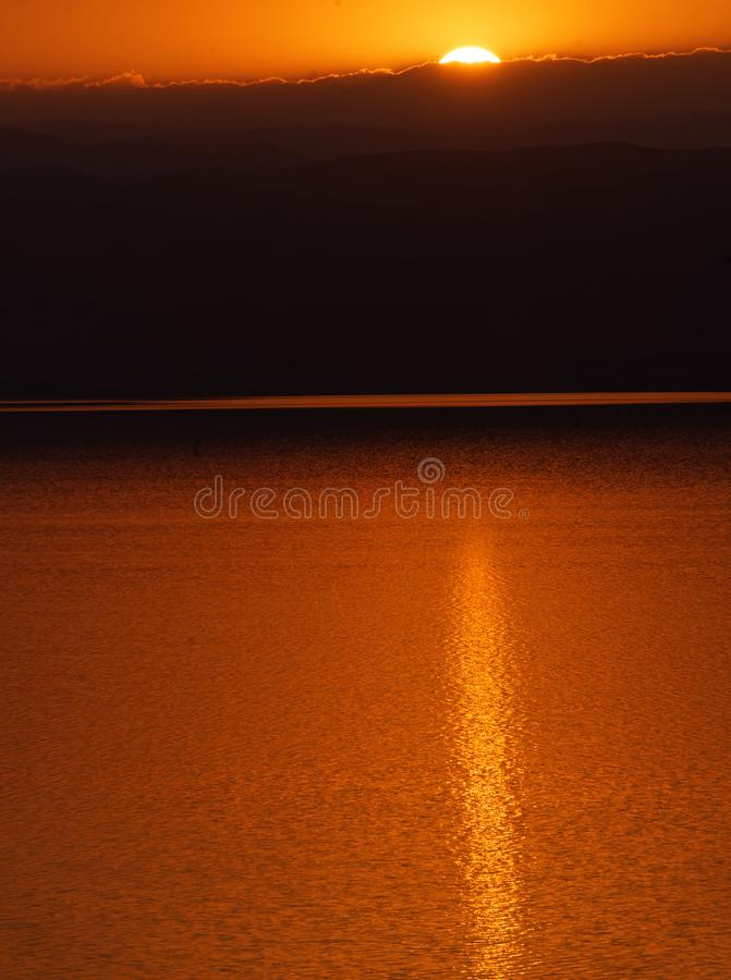 Sunset over the Dead Sea, view from the Jordanian shore to the Israeli mountains stock photos