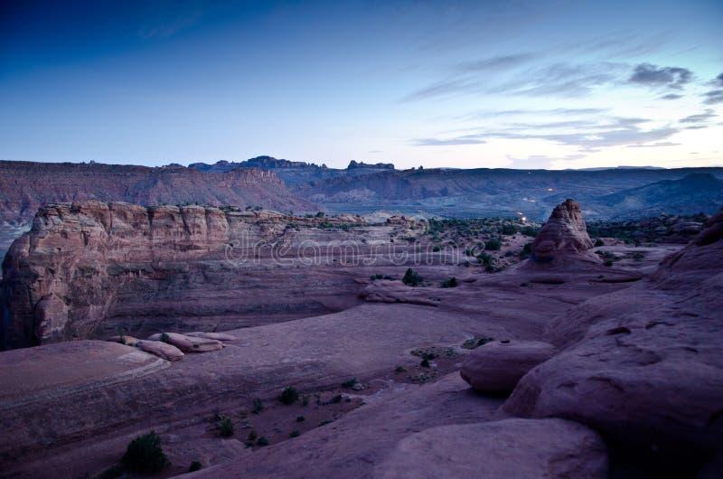 Sunset over desert landscape stock photos
