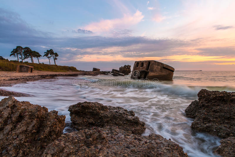 Sunset over destroyed Northern forts. Dramatic cloudy sunset over old destroyed Northern forts on Baltic sea coast in Liepaja, Latvia stock photography