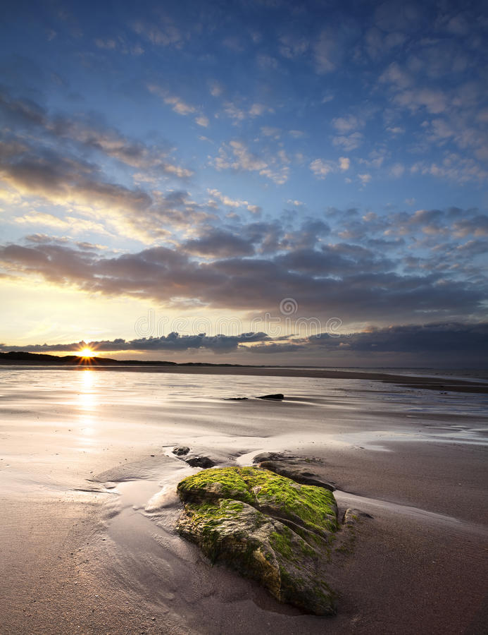 Sunset over Druridge Bay, Northumberland, England royalty free stock images