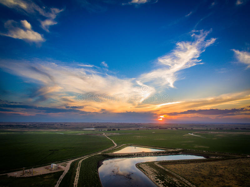 Sunset over Eastern Plains in Colorado. A sunset over a holding pond on the Eastern Plains in Colorado stock image