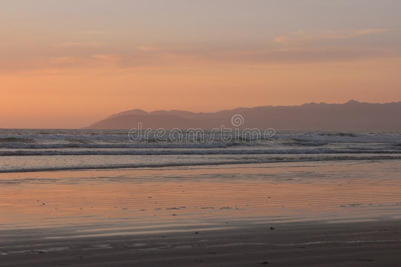 Sunset over an empty Pismo Beach, California. Halfway along the Pacific Coast Highway royalty free stock images