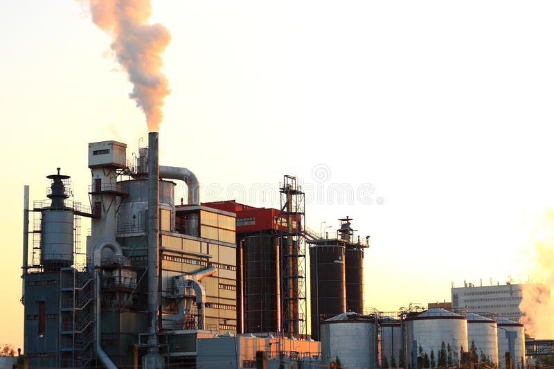 Download Sunset over factory stock image. Image of tree, factory - 21769345