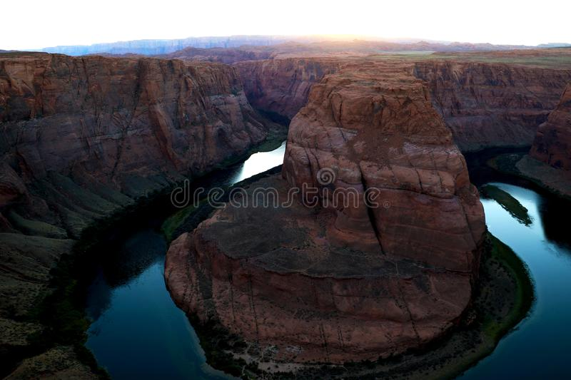 Sunset over famous Horseshoe Bend Utah and Arizona. The beautiful Colorado river carved this horseshoe shaped sandstone reflecting royalty free stock photos