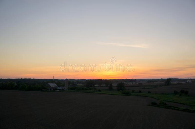 Sunset over farm royalty free stock images