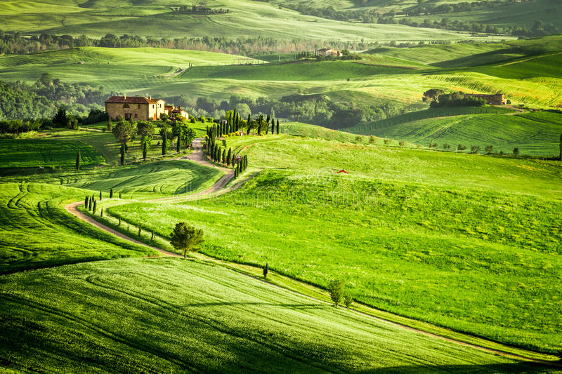Sunset over farmhouse in Tuscany located on a hill. Italy royalty free stock image