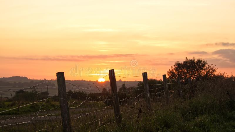 Sunset over farmland in the west of England. Views across South Cornwall as the nights begin to get longer and the air temperature lowers stock image