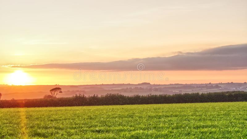 Sunset over farmland in the west of England. Views across South Cornwall as the nights begin to get longer and the air temperature lowers royalty free stock photos