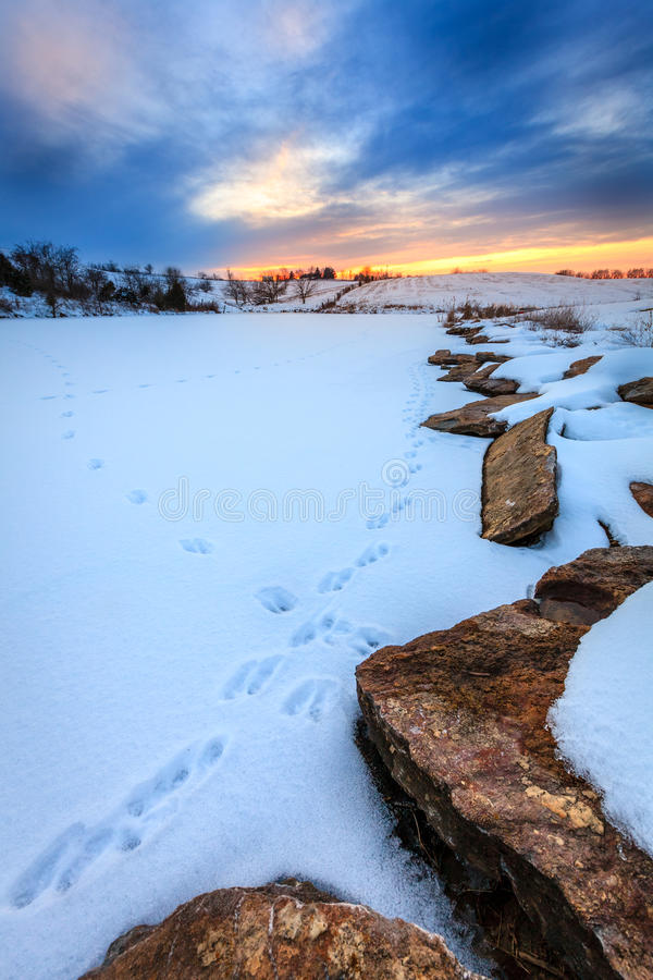 Download Sunset over a frozen lake stock image. Image of evening - 41702731