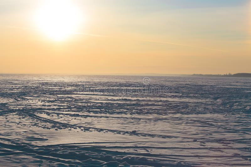sunset over the frozen winter lake royalty free stock photography