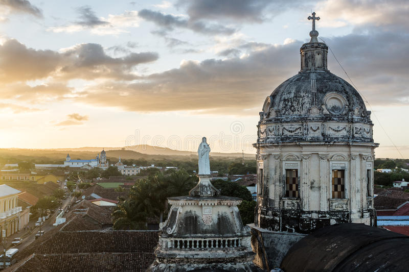 Sunset over Granada with a foreground church royalty free stock photo