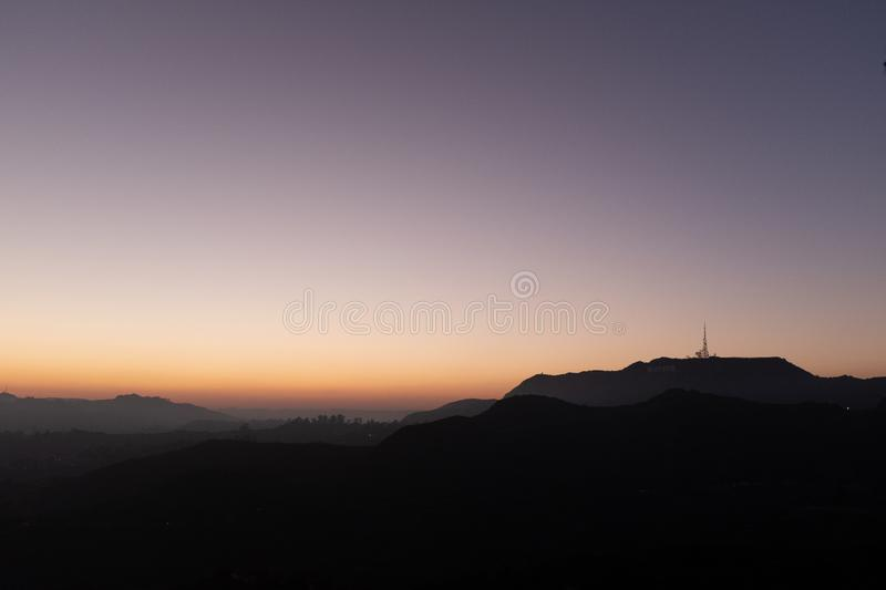 Sunset over the Griffith Park in Los Angeles. Sunset over the Griffith Park at the Los Angeles metro area, California, USA royalty free stock photo