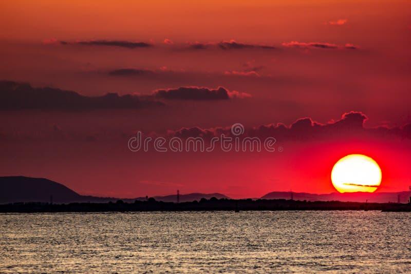Sottomarina sunset. A sunset over the gulf of Venice in Sottomarina, Veneto, Italy. Eraclean, italian, city, comune, metropolitan, adriatic, coast, town, sea stock photos