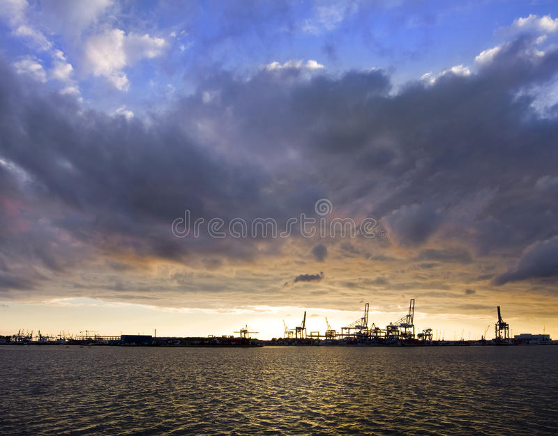 Sunset over harbor stock photography
