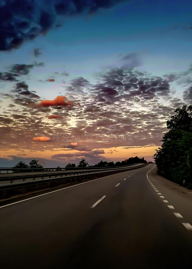 Sunset over highway stock images