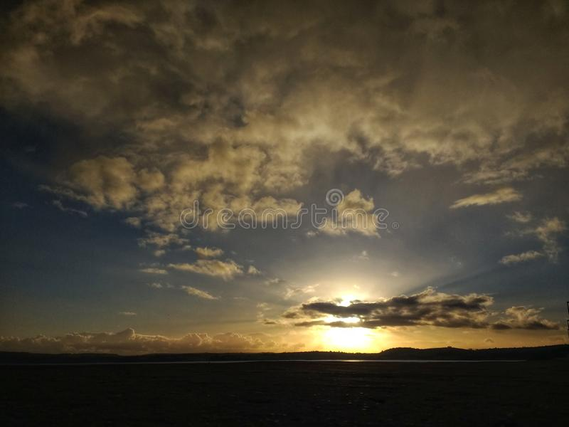 Sunset over hill stock photos