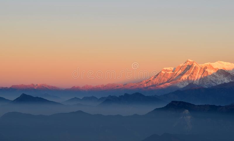 Sunset over Himalayas mountains royalty free stock images