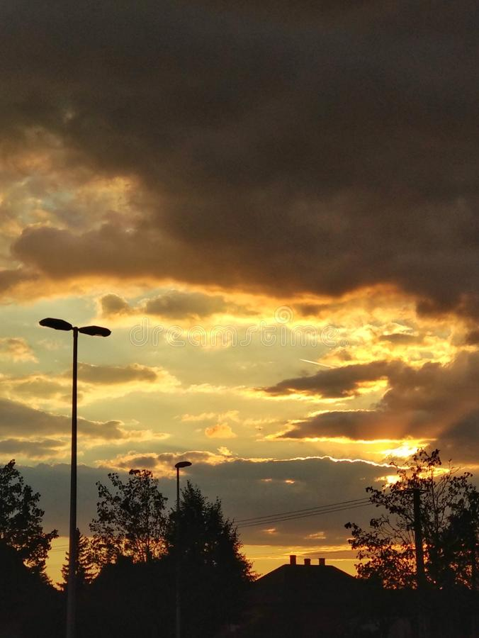 Sunset over hometown royalty free stock images