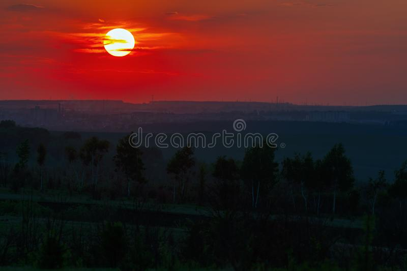 Sunset over the horizon in a cloudy sky.  stock photography